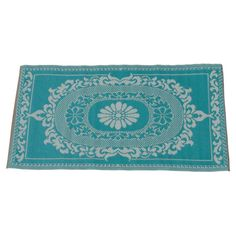 The perfect complement to sandy coloured walls, warm pinks and layered patterns, this sea green rug fits beautifully with a Moroccan scheme.   www.jossandmain.co.uk