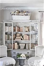French shabby chic library at ;home: Love the old cane baby bassinet with flowers: what a great repurposing for a sentimental object. I'd  totally do this!!