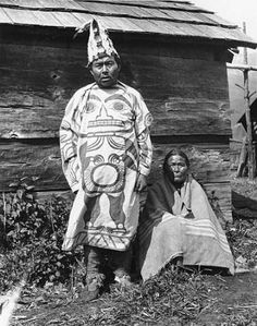 Gitksan man, known as Sam'adi'.k laxsk'L'ik standing next to unidentified woman, Kitwanga, British Columbia, 1910 :: American Indians of the Pacific Northwest