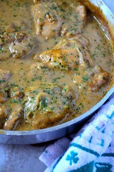 Looking for quick and comforting dinner that doesn't take hours to cook? Try my Smothered Chicken and Gravy recipe! Don't forget the rice or mashed potatoes! Smothered Chicken and Homemade Gravy - Coop Can Cook Smothered Chicken Recipes, Baked Chicken, Chicken Rice And Gravy, Chicken Meals, Stewed Chicken, Chicken Feed, City Chicken Recipe With Gravy, Smothered Chicken Casserole, Chicken Wings