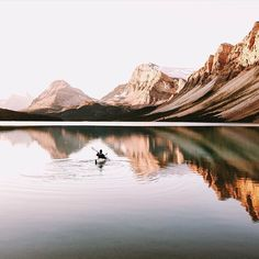 The state of your life is a reflection of your state of mind. #getoutdoors #upknorth Early morning paddle session on Bow Lake, Alberta. Stunning shot by @mattcherub (at Bow Lake, Alberta)