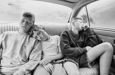 """Photographer Neil Bedford's latest series _Are We There Yet?_ for the new issue of _Kinfolk_ is an absolute summer dream. Capturing three boys as they go on a road trip, we see them skimming stones, napping in the back seat and constantly play-fighting. """"We headed just 30 minutes outside of London to Epping Forrest, a place I'd never been but thought the idea of travelling to a forest for three young boys would be exciting,"""" Neil explains."""