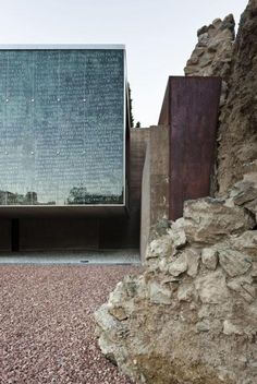 """I'm always drawn to simple forms that create a contrast through materials and textures.  I love how the raw steel wall is acting as a """"body guard"""" for the glass portion, protecting it from the encroaching rugged landscape."""