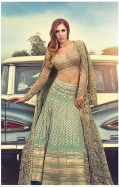 Sangeet Lehengas - Pastel Blue Lehenga with Gold Jacket | WedMeGood Gold Deep Neck full sleeves blouse, Pastel Blue Lehenga with Gold Gota Patti work and gold border, Champagne gold tissue jacket with gold zari work #wedmegood #zari #gotapatti #pastelblue #sangeet #lehenga