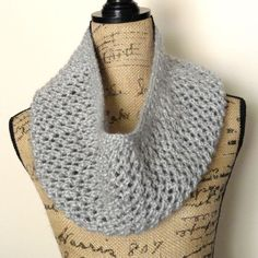 The Mesh Lace Cowl is done with a simple mesh pattern and is perfect for beginning lace knitters. bulky