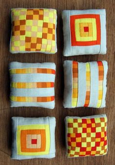 Miniature Patchwork Pincushions:: as is, coasters, inspiration for lap quilts, etc. love the color combos!