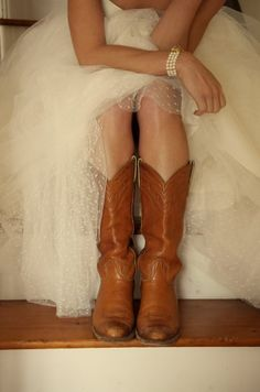 Wedding dress and cowboy boots...I always wear my mom's vintage Frye's that my dad bought her when they were dating, I would totally wear them under my dress!