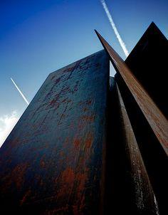 Rusty steel sculpture in the west entrance Liverpool Street station, London.  Fulcrum (1987) by Richard Serra