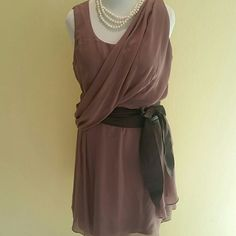 Grecian style dress. Dusty rose/ mauveish color Elegant grecian style dress.  Draped fabric on bodice, flowy skirt, can be belted.  Hits above knee.  The dress is very flattering and different.  Photo #3, has some pull on fabric, its not noticeable at all however i want to let you know.  Best worn with Obi belt.  Belt not included. osp Dresses