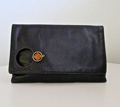 Susan Gail Clutch - Signed Large Black Leather Clutch Orange and Gold Clasp. $23.00, via Etsy.  *Moth Eaten Deer Head