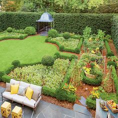 Suburban Kitchen Garden - Landscaping with Boxwoods - Southern Living--wall off the orchard!