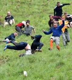 Contestants take part in the men's race at the annual cheese rolling festival on Cooper's Hill in Gloucestershire, England Cheese Rolling, Pictures Of The Week, Bbc News, Good News, The Man, Carnival, Folklore, Sports, Art Ideas