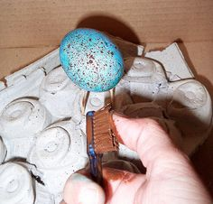 Use a toothbrush to make speckled eggs. | 29 Insanely Easy Ways To Get Ready For Easter