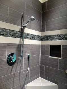 custom walk in shower using a large profile tile with a nice linear band for an - Tiled Bathrooms Designs