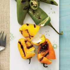 Cheese-Stuffed Grilled Peppers   Wine experts Robert Perkins and John Lancaste love making this snack at backyard barbecues using all types of medium-sized peppers. As the peppers blister, the cheese mixture tucked inside turns warm and gooey.