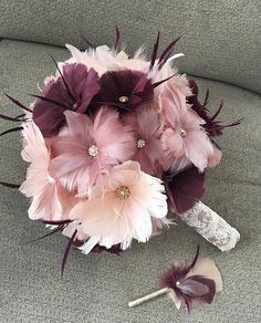 Large size bouquet shown. This romantic one of a kind Old Hollywood Style bouquet is sure to be a beautiful compliment to your wedding day! Perfect bouquet for your Gatsby, Vintage, Masquerade, Modern or Traditional wedding. Each flower is hand crafted with the best quality silky feathers and your choice silver or gold rhinestone brooches and pearls. The bouquet shown displays romantic shades of blush, rose and plum and is accented with gold tone centerpieces. Also available with silver…