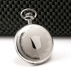 Quartz Pocket Quartz 3544: This ornately detailed stainless steel pocket watch has a large open area on the back case for engraving. Watch features date function and sweep second hand. Precision quartz movement made with swiss parts.
