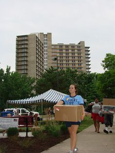 When the box tumbled from a parent's grasp to the ground in front of Mae Smith Hall during move-in day, Brian Freeburg was on the job instantly, providing both assistance and humor. University Housing, Moving Day, New Students, Parenting, Freshman Year, Childcare, Natural Parenting