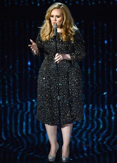 Singer Adele performs onstage during the Oscars held at the Dolby Theatre on February 24, 2013 in Hollywood, California.