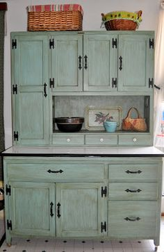 Hoosier cabinet......same style as mine but mine looks way cooler!! Lol!! ;)