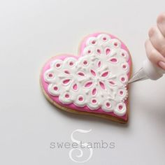 Watch the full video on how to decorate eyelet lace cookies with royal icing at YouTube.com/SweetAmbsCookies!  MUSIC: