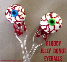 Powdered donuts with jelly injected inside.  Add M as pupils with a FoodWriter pen.