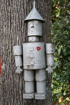 Recycle tin cans for garden art art from junk upcycling Tin man Tin Can Man, Tin Man, Recycled Tin Cans, Recycled Art, Recycled Clothing, Recycled Fashion, Repurposed, Tin Can Crafts, Diy Crafts