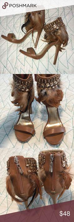 "Bebe heels Bling and feathers heels worn once! No stones missing. 4"" heels. They look super hot on. bebe Shoes Heels"
