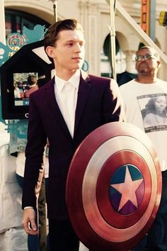 I don't know why he is holding the shield but man he looks hot while doing it