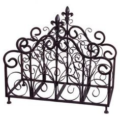 """Organize your space in style with this eye-catching essential, perfect for keeping a chic and orderly home.   Product: Magazine rackConstruction Material: Tube iron and sheet ironColor: BlackFeatures:  French quarter inspiredFleur-de-lies detail Dimensions: 19"""" H x 21"""" W"""