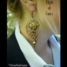 """Flight of Fancy. Earrings that combine working propellers, compass dials, clock pendulums and vintage filigree into superb Steampunkery. By #AlchemyDivineCouture #Steampunkearrings $49USD  Featuring a beautifully antiqued copper Wing , an antiqued silver Compass, gold Propeller and Pendulum. Each earring measures 2 1/2"""" in length from base of ear wire and 1 1/4"""" wide.  What I love best about these earrings is that they have so much movement as you wear them. The propeller twirls freely as…"""