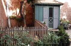 cute cottage-style chicken coop w/ attached fenced in area. doesn't even look like a coop!!