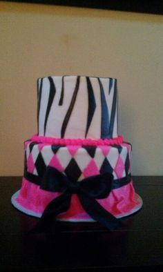 2 tiered cake with fondant zebra striped, argyl pattern and skirt