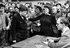 Henri Cartier-Bresson - Among liberated DPs going home an informer of the Gestapo tried to slip among them, Dessau, Germany, 1945