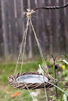 The Hippy Homemaker: Easy DIY Bird Bath  This looks easy, I see those old wreaths all the time at goodwill.