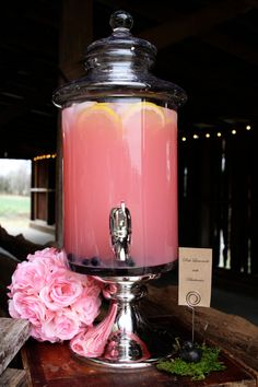 Pink Lemonade with blueberries and lemons in my drink urns. Rustic, country barn pink/blush wedding food buffet and drink station by ShinDigs Event Decorating. Catering by Tasteful Gatherings. Photo by Brittany Toomey. The Murphy Farm, Etowah, TN. www.pinterest.com/shindigsevdec/styled-wedding-shoot-murphy-farm-etowah-tn/