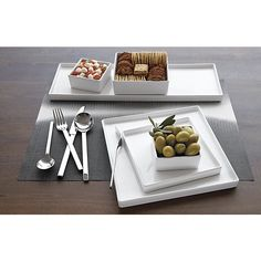 Shop set of 8 bento dinner plates.   Go-to, go with everything dinnerware turns a corner in smart white stoneware.  Raised rims square off interactive plates.