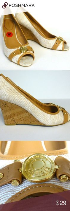 """Tommy Hilfiger 10 wedge open toe pumps New no box New unworn display shoes show signs of being tried on. Soles have writing on the bottom. Cork wedge 3"""" heel. Textile upper with peep toe and coin logo trim. Padded insole. Synthetic lining and sole. Tommy Hilfiger Shoes Wedges"""