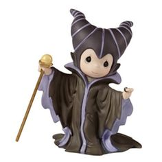 Dressed as her favorite Disney villain in long flowing black robes, this darling pretends to be the dark fairy, ready to cast a spell upon an unsuspecting princess. Of course it is all in good fun, an