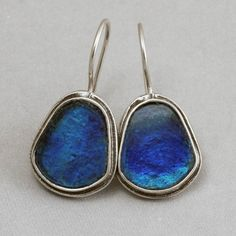 The mesmerizing blues of the ancient Roman glass are framed in the sterling silver pear setting. Handmade in Israel.