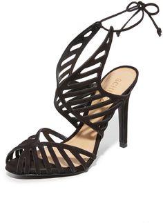 Smooth nubuck Schutz sandals in a scalloped silhouette with slim cutouts. Lace-up ties in back. Covered heel and leather sole. <ul> <li>Leather: Cowhide.</li> <li>Imported, Brazil.</li> <li>Measurements</li> <li>Heel: 4in / 100mm</li> </ul>