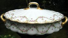 Antique Oval Covered Pedestal Tureen Of Theodore Haviland Limoges Schleiger #1114    Pattern is Schleiger #1114 On Blank 305    Haviland Limoges Schleiger #1114 Pattern Features Garlands Of Pink Roses On A Double Gold Trimmed Scalloped Blank    $160.00