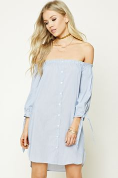An off-the-shoulder mini dress featuring a pinstripe pattern, 3/4 sleeves with self-ties, a button front, on-seam pockets, and a dolphin hem.