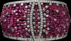 "CARTIER. ""Disa"" Bracelet - white gold, ruby beads, brilliant-cut diamonds."