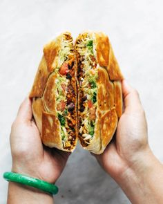 This vegan crunchwrap is INSANE! Stuff this bad boy with whatever you like - I made it with sofritas tofu and cashew queso - and wrap it up, fry, and devour! Favorite vegan recipe to date. #vegan #veganrecipe #crunchwrap #vegancrunchwrap #sofritas #cashewqueso | pinchofyum.com