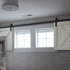 Barn door sliding window option for basement