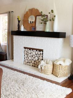 It's a silly stylist trick, but a stack of wood logs (birch, or another light wood) looks awfully pretty in a fireplace. But there has to be an easier way…