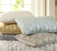 Fun accent pillows in Porcelain Blue to add more texture & subtle color. Isabelle Tufted Voile Quilt & Shams | Pottery Barn. 49-59.00 ea. I would recommend doing 2 standard shams to put in front of your regular pillows & layer the monogrammed pillow in front of these. You could do the cream or white in these as well if you decide to go with the white & royal blue duvet.