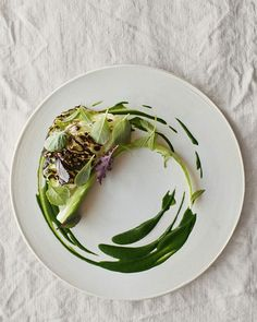 green salad on white plate, wrinkled table cloth