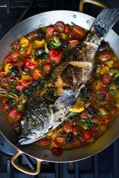 Don't let any part of the fish go to waste—roast a bass in full with bright cherry tomatoes.